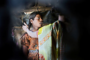 Poonam, 11, is arguing with her mother Sangita, 40, while standing inside the kitchen area of their newly built home in Oriya Basti, one of the water-affected colonies in Bhopal, Madhya Pradesh, India, near the abandoned Union Carbide (now DOW Chemical) industrial complex.