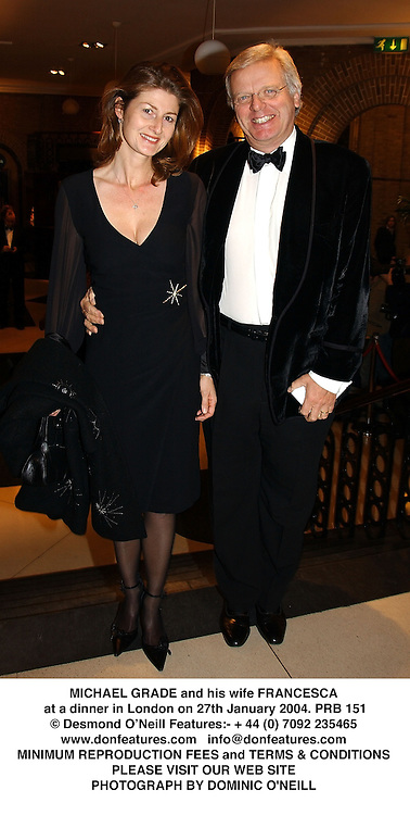 MICHAEL GRADE and his wife FRANCESCA at a dinner in London on 27th January 2004.PRB 151