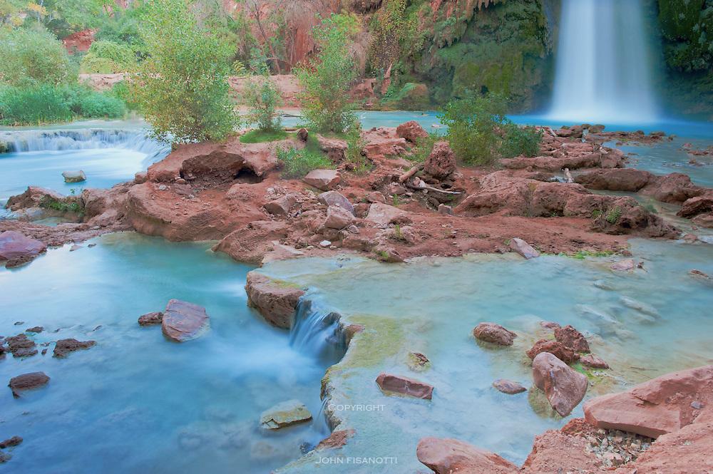 Travertine pools form at the base of Havasu Falls
