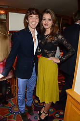 RICHARD MARTIN and CRESSIDA STEWART at Tatler Magazine's Little Black Book Party held at Annabel's, Berkeley Square, London on 5th November 2013.