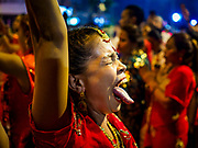 30 SEPTEMBER 2017 - BANGKOK, THAILAND:  A woman in a trance like state during the Navratri parade in Bangkok. Navratri is a nine night (10 day) long Hindu celebration that marks the end of the monsoon and honors of the divine feminine Devi (Durga). The festival is celebrated differently in different parts of India, but the common theme is the battle and victory of Good over Evil based on a regionally famous epic or legend such as the Ramayana or the Devi Mahatmya. Navratri is celebrated throughout Southeast Asia in communities that have large Hindu population. Bangkok's celebration of Navratri was subdued this year because Thais are still mourning the death of Bhumibol Adulyadej, the Late King of Thailand, who died on October 13, 2016.     PHOTO BY JACK KURTZ