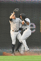 May 18, 2018 - Kansas City, Missouri, U.S. - KANSAS Kansas City, MO - MAY 18:  New York Yankees left fielder Brett Gardiner (11) catches a fly ball as New York Yankees center fielder Aaron Hicks (31) pulls away in time during a Major League Baseball game between the New York Yankees and the Kansas City Royals on May 18, 2018, at Kauffman Stadium, Kansas City, MO. Kansas City won, 5-2.  (Photo by Keith Gillett/Icon Sportswire) (Credit Image: © Keith Gillett/Icon SMI via ZUMA Press)