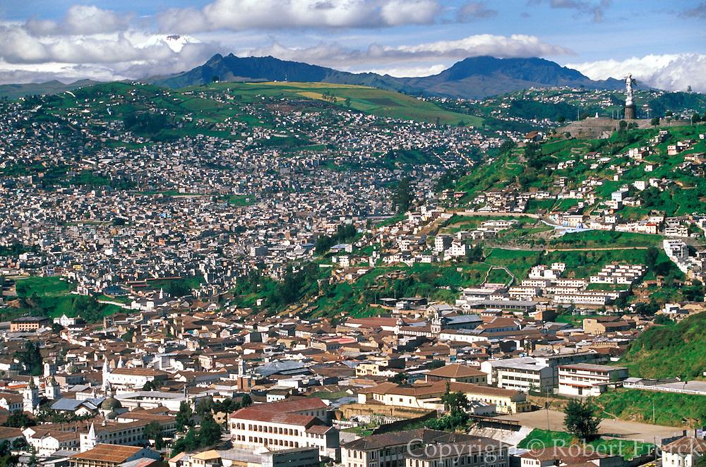 ECUADOR, QUITO, SKYLINE view of Quito with Cotopaxi volcano