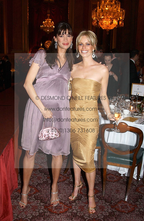 Left to right, LISA BILTON and CAROLINE HABIB at a fashion show and dinner hosted by Shangri-la Hotels and Resorts and Andy Wong featuring fashion by new designer Lu Kun held at The Goldsmiths Hall, Foster Lane, London on 25th April 2005.<br /><br />NON EXCLUSIVE - WORLD RIGHTS