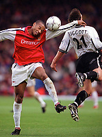 Thierry Henry (Arsenal) and Chris Riggott (Derby) jump for the ball. Arsenal 0:0 Derby County. F.A. Premiership, 11/11/2000. Credit: Colorsport / Stuart MacFarlane.