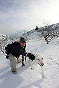 A hunter directing his labrador to fetch a ptarmigan at the ski chalet, Kodiak, Alaska.  MR, MA
