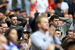 Millwall fans look nervous in the stands as the final whistle aproaches during the Sky Bet League One play off final at Wembley Stadium, London.