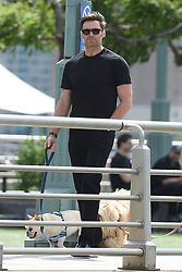 EXCLUSIVE: Hugh Jackman races his daughter while out for a walk with wife Deborra and their dogs in NYC. 26 May 2017 Pictured: Hugh Jackman. Photo credit: MEGA TheMegaAgency.com +1 888 505 6342