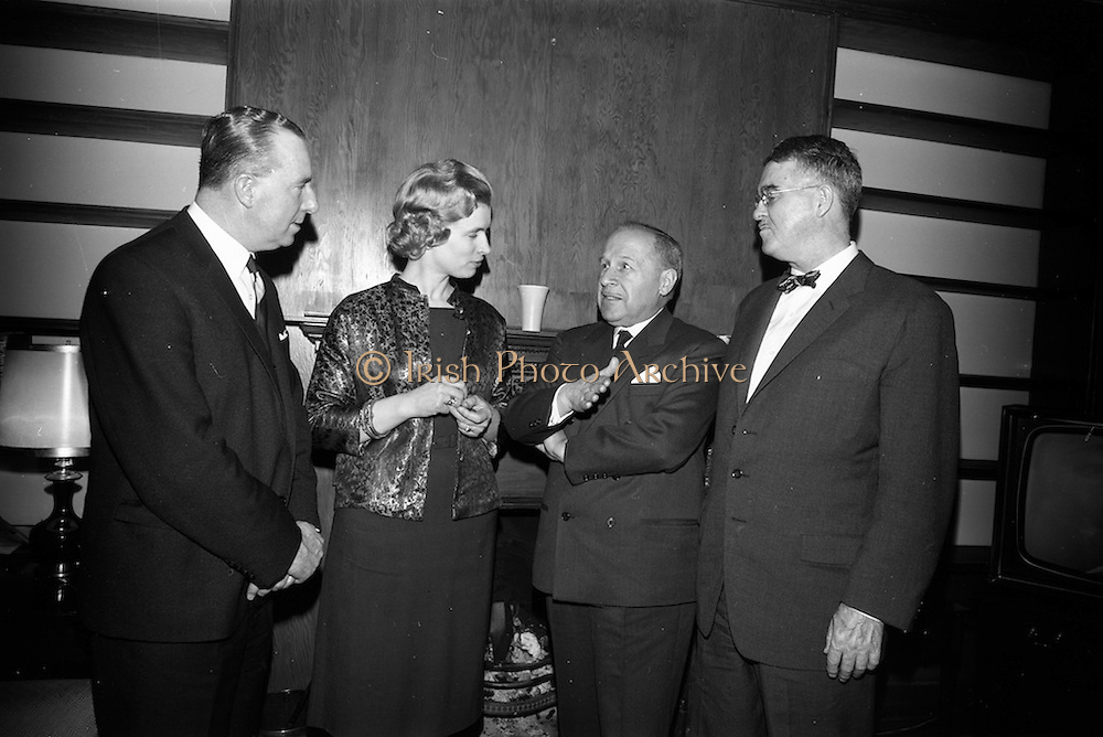 09/04/1964<br /> 04/09/1964<br /> 09 April 1964<br /> Canadian Embassy Reception for Pierre Dupuy, C.M.G., Commissioner General of the Canadian Universal and International Exhibition 1967, at the Canadian Embassy in Killiney, Dublin. Pictured at the reception were (l-r): Lieut-General Sean Mac Eoin; Mrs E.T. Galpin; Mr Pierre Dupuy and  Mr P.V. McLane, Canadian Charge D'Affairs.