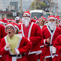 People in Santa Claus costume participate the first ever mass Santa Run in central Budapest, Hungary on December 06, 2014. ATTILA VOLGYI