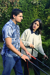 Single mother gardening with teenage son,