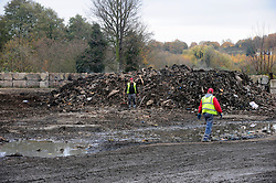 © Licensed to London News Pictures.18/11/2017.<br /> Orpington, UK.<br />  Workmen and the last of the waste.<br /> The infamous Waste4fuel rubbish site in Orpington is due to be totally clear of waste on Monday. Work began to clear the site from 27.000 tons of waste a year ago at Cornwall Drive, Now the site has about 27 tons of rubbish left to clear. Altogether the clearance cost of the waste mountain has come to around £4.5 million with most of the money coming from government and the Enviroment Agency.<br /> Photo credit: Grant Falvey/LNP