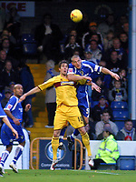 Photo: Dave Linney.<br />Cardiff City v Burnley. Coca Cola Championship. 11/11/2006. Cardiff's Darren Purse(R) beats  Andy Gray<br />to the header.