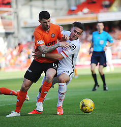 Dundee United's Mark Durnan and Inverness Caledonian Thistle's Miles Storey. <br /> Dundee United 1 v 1 Inverness Caledonian Thistle, SPFL Ladbrokes Premiership game played 19/9/2015 at Tannadice.