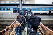 People changing trains in Cheb close to the German border. A lot less commuters and travellers are visible after the Coronavirus pandemic (COVID-19) outbreak - pictured on the 11th of March 2020.