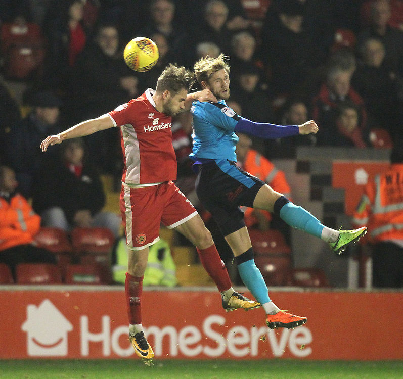 Fleetwood Town's Wes Burns jumps with  Walsall's Luke Leahy<br /> <br /> Photographer Mick Walker/CameraSport<br /> <br /> The EFL Sky Bet League One - Walsall v Fleetwood Town - Tuesday 21st November 2017 - Bescot Stadium - Walsall<br /> <br /> World Copyright © 2017 CameraSport. All rights reserved. 43 Linden Ave. Countesthorpe. Leicester. England. LE8 5PG - Tel: +44 (0) 116 277 4147 - admin@camerasport.com - www.camerasport.com