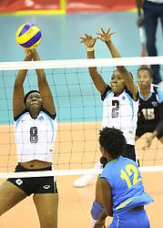 Demitrie Muhimpunda of Rwanda spikes Tshiamo Chakalisa and Jestinah Moyo of  Botswana during their U23 Africa Nations Championship at Safaricom Stadium Stadium in Nairobi on October 26, 2016. Rwanda won 3-0. Photo/Fredrick Onyango/www.pic-centre.com (KEN)