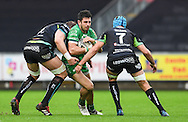 Connacht's Tiernan O'Halloran is tackled by Ospreys' Alun Wyn Jones (l). <br /> <br /> Guinness Pro12 rugby match, Ospreys v Connacht rugby at the Liberty Stadium in Swansea, South Wales on Saturday 7th January 2017.<br /> pic by Craig Thomas, Andrew Orchard sports photography.