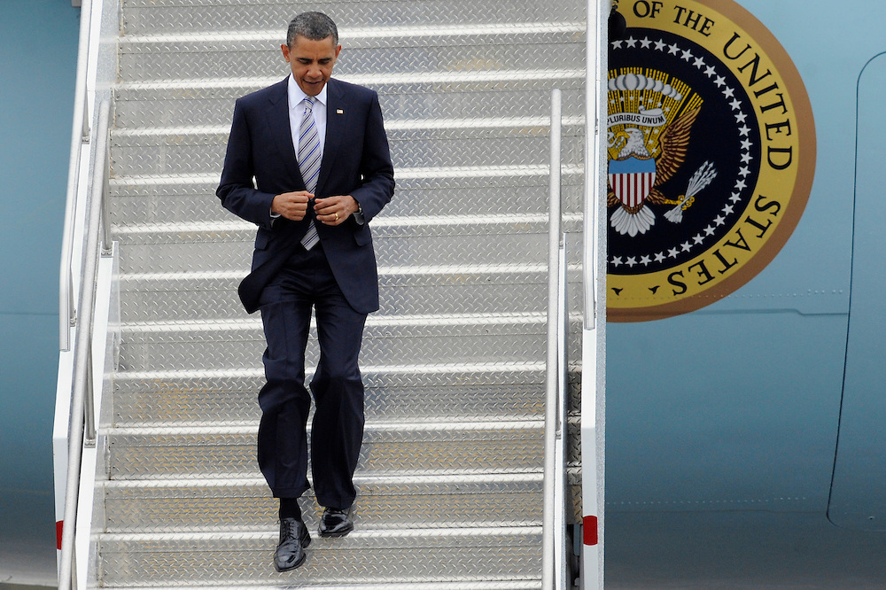 President Obama arrives at the Bradley Air National Guard Base in East Granby, Conn., Wednesday, May 18, 2011.  The President is in Connecticut to speak at the U.S. Coast Guard Academy's 130th commencement. (AP Photo/Jessica Hill)