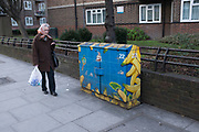 Brightly painted with bananas and exploration design, a telecoms junction box on Union Street in South London.