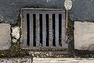 Maintenance Hole- and Drain Covers of Wirral by Colin McPherson, 2020-21.<br /> <br /> A gully cover manufactured by O. Jones of Birkenhead, a company which supplied numerous covers in Wirral before local government reorganisation in the 1970s. The company no longer exists.