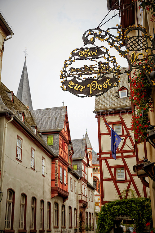 View of a Bacharach street with a cafe, tudor style architecture, and a cafe, Bacharach, Germany.