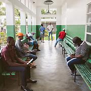 INDIVIDUAL(S) PHOTOGRAPHED: N/A. LOCATION: Sacré-Cœur Hospital, Milot Commune, Cap-Haïtien, Haïti. CAPTION: People wait to receive care at the Sacré-Cœur Hospital in Milot.