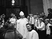 Episcopal Ordination Of Desmond Connell. (R74).1988..06.03.1988..03.06.1988..6th March 1988..Following the death of Archbishop Kevin McNamara in April '87, Pope John Paul II surprisingly nominated Desmond Connell for the position of Archbishop of Dublin. The ordination of Dr Connell took place at the Pro-Cathedral in Dublin...Image shows the Archbishop of Dublin, Desmond Connell, coming out to meet his 'flock' outside the Pro-Cathedral after the Episcopal Ordination.
