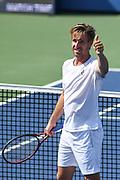 PETER GOJOWCZYK reacts after winning at the Rock Creek Tennis Center.