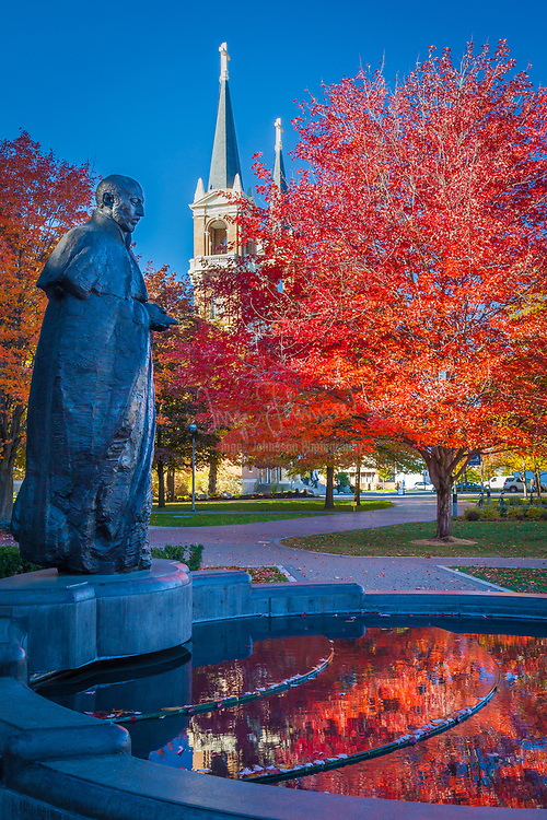 Statue of St Ignatius at Gonzaga University in Washington state. Gonzaga University is a private Roman Catholic university located in Spokane, Washington, United States. Founded in 1887 by the Society of Jesus, it is one of 28 member institutions of the Association of Jesuit Colleges and Universities. It is named for the young Jesuit saint Aloysius Gonzaga. The campus houses 105 buildings on 152 acres (62 ha) of grassland along the Spokane River, in a residential setting one-half-mile from downtown Spokane. The university was founded by Father Joseph Cataldo, SJ, an Italian-born priest and missionary. He established the Catholic school for local Native Americans whom he served. The university offers bachelor's degrees, master's degrees, and doctoral degrees through its seven colleges, the College of Arts and Sciences, School of Business Administration, School of Education, School of Engineering & Applied Science, School of Law, School of Nursing and Human Physiology, and the School of Professional Studies.