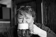 "Czech photographer Libuše Jarcovjáková drinking a beer at the ""Orlik"" pub in Prague  where she spent long nights in the 1970's. Libuše Jarcovjáková's work is an authentic record of the life of a photographer who experienced everything she shot. She uses a personal, clearly-composed style, mixing the raw with the poetic. The street, night, sex, work, alcohol, love, and depression are captured with a self-destructive lack of restraint."