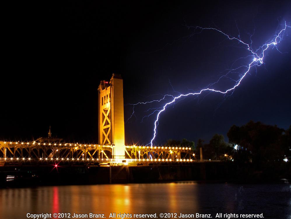 Cloud to ground lightning over the Tower Bridge in Sacramento, California.