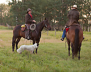 Photo Randy Vanderveen.Near Debolt, Alberta, July 22/08.A pair of cowboys on horse back hold up for a moment to talk.