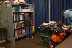 """School is open five days a week in the one-room schoolhouse, which is set up in every city where the show pitches its tent, for all of the school-age children of the circus. The traveling school uses a nationally recognized home-schooling curriculum. <br /> Ringling Bros. and Barnum & Bailey Circus started in 1919 when the circus created by James Anthony Bailey and P. T. Barnum merged with the Ringling Brothers Circus. Currently, the circus maintains two circus train-based shows, the Blue Tour and the Red Tour, as well as the truck-based Gold Tour. Each train is a mile long with roughly 60 cars: 40 passenger cars and 20 freight. Each train presents a different """"edition"""" of the show, using a numbering scheme that dates back to circus origins in 1871 — the first year of P.T. Barnum's show."""