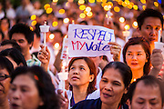 """12 JANUARY 2014 - BANGKOK, THAILAND:  A pro-democracy vigil at Thammasat University in Bangkok Sunday. About 500 people from all walks of Thai life came to the vigil at Thammasat University. They prayed for a peaceful resolution to the political conflict in Thailand. They finished the vigil by singing the John Lennon song """"Imagine."""" Anti-government protestors are expected """"Shutdown Bangkok"""" Monday. There were reports Sunday evening that some intersections were already being blocked.      PHOTO BY JACK KURTZ"""