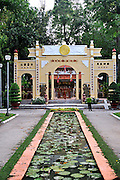Ornamental pond leading to gates of Buddhist Temple in Cong Vien Van Hoa Park, Ho Chi Minh City (Saigon), Viet Nam.