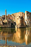Remains of medieval Artukid Old Tigris Bridge – Built in 1116 by Artukid Fahrettin Karaaslan, the biggest in Anatolia at the time, with the old town Hasankeyf and its ruins on the cliffs abover the river Tigris. The minaret is of the El Rizk Mosque built 1409.  Turkey. 4 .<br /> <br /> If you prefer to buy from our ALAMY PHOTO LIBRARY  Collection visit : https://www.alamy.com/portfolio/paul-williams-funkystock/hasankeyf-turkey.html<br /> <br /> Visit our PHOTO COLLECTIONS OF TURKEY HISTOIC PLACES for more photos to download or buy as wall art prints https://funkystock.photoshelter.com/gallery-collection/Pictures-of-Turkey-Turkey-Photos-Images-Fotos/C0000U.hJWkZxAbg