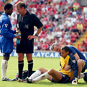 Chelsea's goalkeepr Carlo Cudicini is given medical attention after a collison with Charlton Athletic's Jason Euell.
