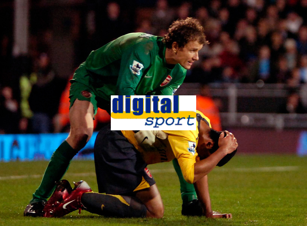 Photo: Ed Godden.<br /> Fulham v Arsenal. The Barclays Premiership. 29/11/2006.<br /> Arsenal keeper Jens Lehmann picks Theo Walcott up after getting a bash to the head.