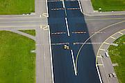 Nederland, Noord-Holland, Haarlemmermeer, 12-05-2009; luchthaven Schiphol, kruising van taxibaan (behorende bij de Polderbaan) met de Zwanenburgbaan.Swart collectie, luchtfoto (toeslag); Swart Collection, aerial photo (additional fee required).foto Siebe Swart / photo Siebe Swart