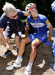 July 24, 2018 - Bagneres De Luchon, France - PHILIPPE GILBERT of Belgium Quick-Step Floors waits for medical assistance after crashing during stage 16 of the 105th edition of the 2018 Tour de France cycling race, a stage of 218 kms between Carcassonne and Bagneres-De-Luchon in Bagneres-De-Luchon, France. The accident has caused him to withdraw from the race.  (Credit Image: © Panoramic via ZUMA Press)