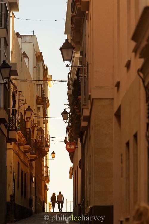 Couple on street in Cadiz, Spain