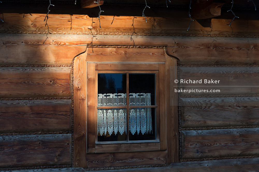 An ornate wooden window of the Bocowka restaurant, a traditional mountain log cabin in southern Poland, on 21st September 2019, in Jaworki, near Szczawnica, Malopolska, Poland.
