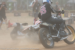 Number 100 Josh McDonald crashing on the Fist City Flat Track at the Tennessee Motorcycles and Music Revival at Loretta Lynn's Ranch. Hurricane Mills, TN, USA. Saturday, May 22, 2021. Photography ©2021 Michael Lichter.