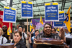 London, UK. 15 July, 2019. Catering and cleaning staff belonging to the PCS trade union and outsourced to work at the Department for Business, Energy and Industrial Strategy (BEIS) via contractors ISS World and Aramark stand on the picket line outside the Government department after walking out on an indefinite strike for the London Living Wage, terms and conditions comparable to the civil servants they work alongside and an end to outsourcing.