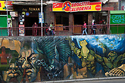 Bolivia June 2013. La Paz. Wall painting on an underpass and Fast food restaurant, Broaster California.