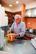 Israel, Haifa, Man makes Falafel - Deep fried Ground chickpeas the paste before frying