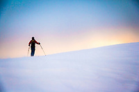 Mark Borges surveys the Park City Ridgline during a dawn patrol in the Wasatch.