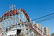 The iconic Cyclone at Coney Island's Luna Park, one of the oldest operating wooden roller coasters. The ride is nearly a half mile long and has an initial drop of 85 feet.