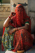 Traditional Indian woman in red scarf Rajasthan, India